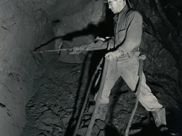 Miner uses air-pressured drill in the mines in Lyon Mountain