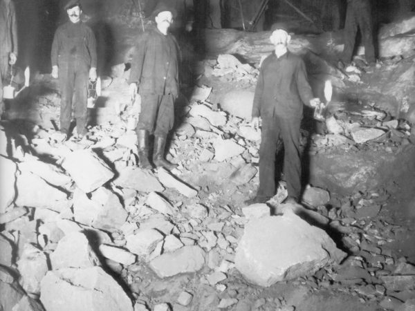 Miners underground with oil lamps in Lyon Mountain