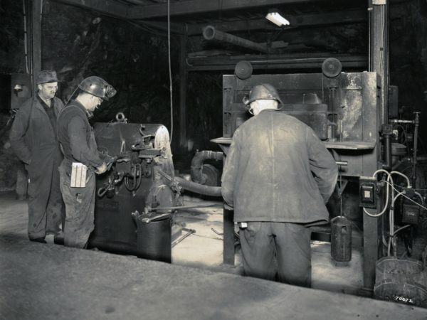 Roy Hicks and Joe Pascal in mine drill shop in Lyon Mountain