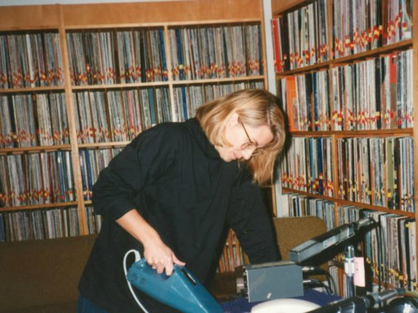 Martha Foley vacuums in the record room at NCPR in Canton
