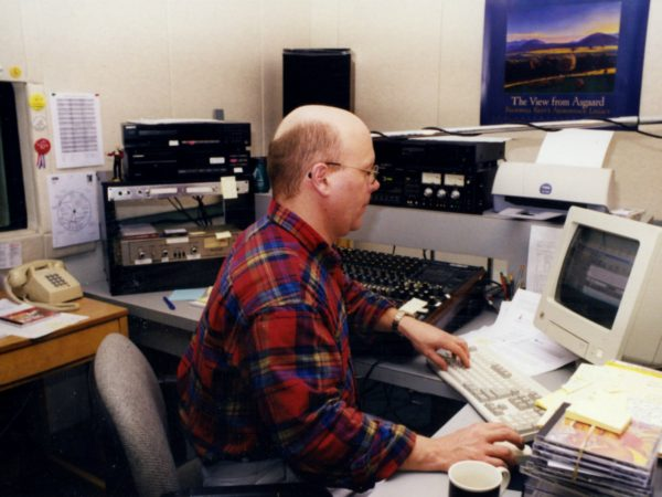 Morning show host Todd Moe works at computer at NCPR in Canton
