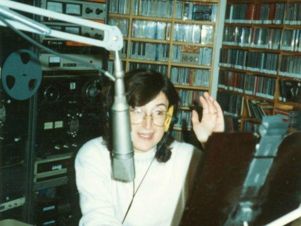 Jackie Sauter speaks into microphone at NCPR in Canton