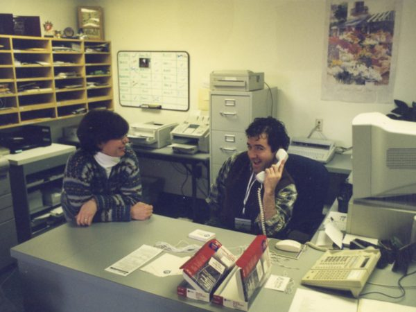 Kelly Trombley and David Sommerstein at front desk of NCPR in Canton