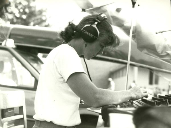 Beverly Hickman of NCPR mixes sound at a music festival in Paul Smiths