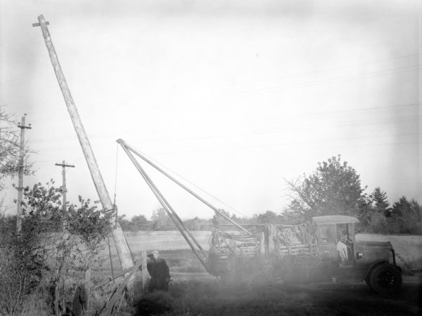 Erecting Northern New York Telephone poles in Clinton County |