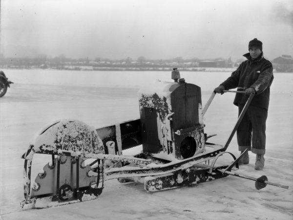 Man operating ice cutting machine on Plattsburgh Bay