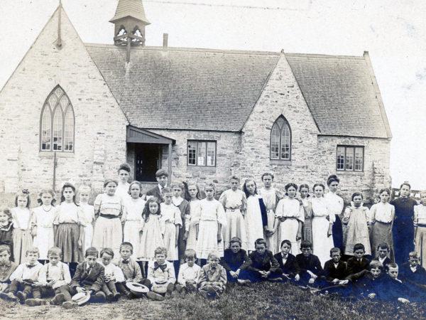 Schoolchildren and teacher outside the Morley Schoolhouse