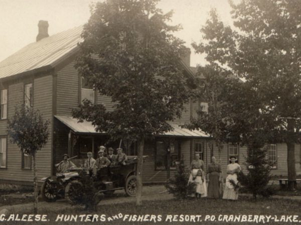 Employees with hunting expedition in front of Mountain House of Windfall in Cranberry Lake