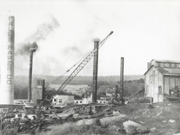 Paper mill chimney under construction in Newton Falls