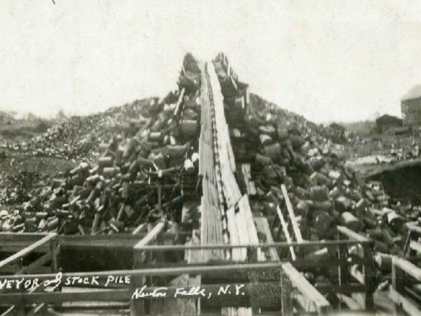 Pulpwood conveyor and stockpile at the paper mill in Newton Falls