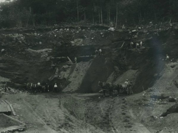 Miners in a gravel pit with teams of horses in Benson Mines
