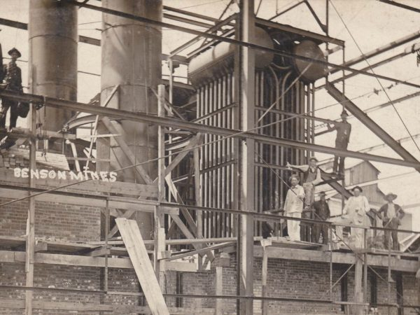 Workers on top of the Benson mine plant building framework. Circa 1910. Benson Mines, NY.
