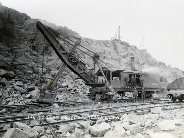 Men with a Bucyrus rail mounted steam shovel in Benson Mines