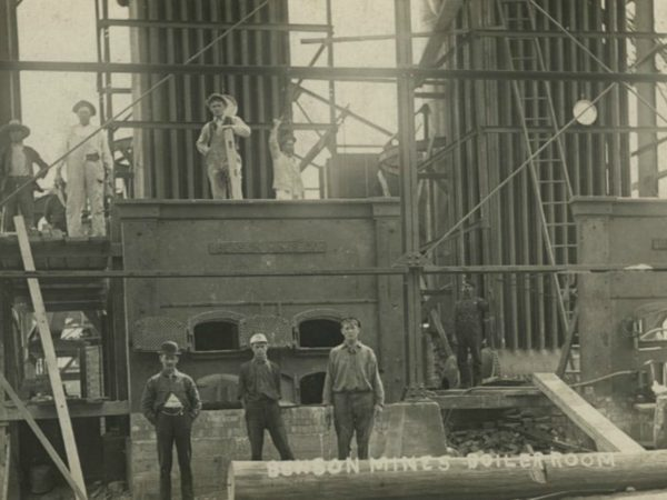Workers outside the boiler room at Benson Mines