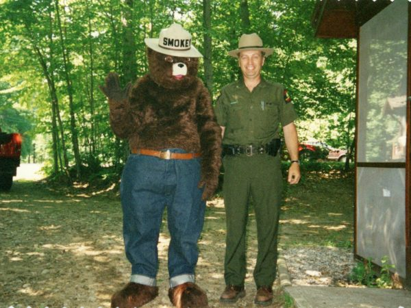 Forest ranger with Smokey the Bear at a campground in Cranberry Lake