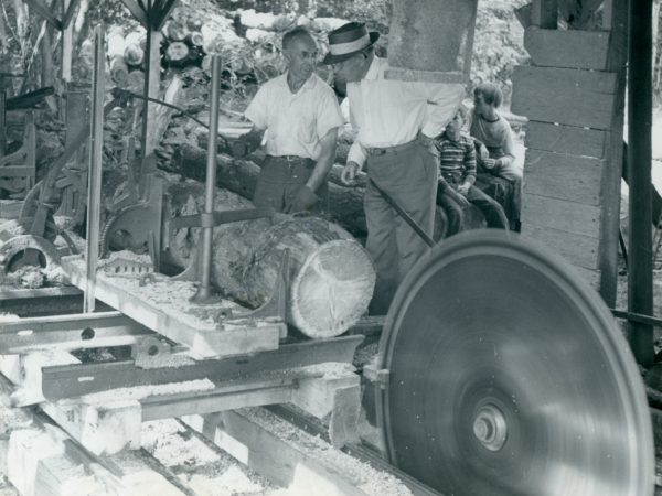 Two men cutting logs at the Hayes Sawmill in Cranberry Lake