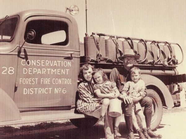 Mose LaFontaine with his Conservation Department truck in Cranberry Lake