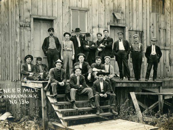 Workers on the steps of the veneer mill in Wanakena