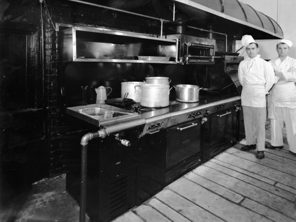 Chefs at cooking range in Clinton County