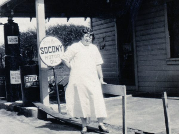 Grace LaParr in front of SUCONY gas station in Cranberry Lake
