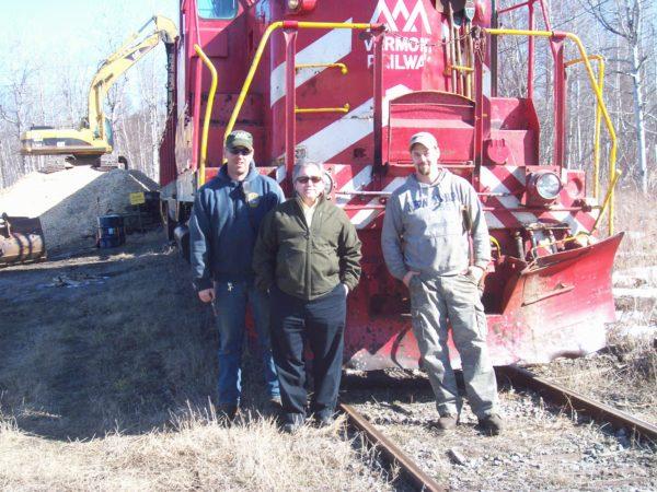 Rail yard crew loading wood chips at the Norfolk rail yard