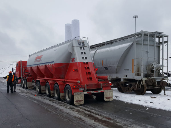 Fly ash being trans-loaded from rail cars to trucks at Seaway Bulk Services