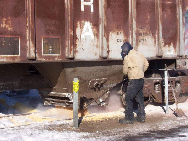 "Roger ""Bucky"" Taylor unloading grain at the Port of Ogdensburg"
