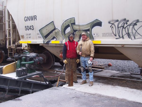 Unloading road salt from rail cars in Ogdensburg
