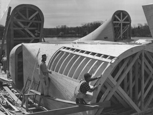 Two carpenters constructing a draft tube in South Colton