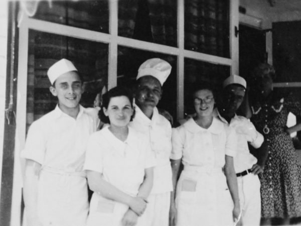 Employees in front of the Golden Anchor in Clayton
