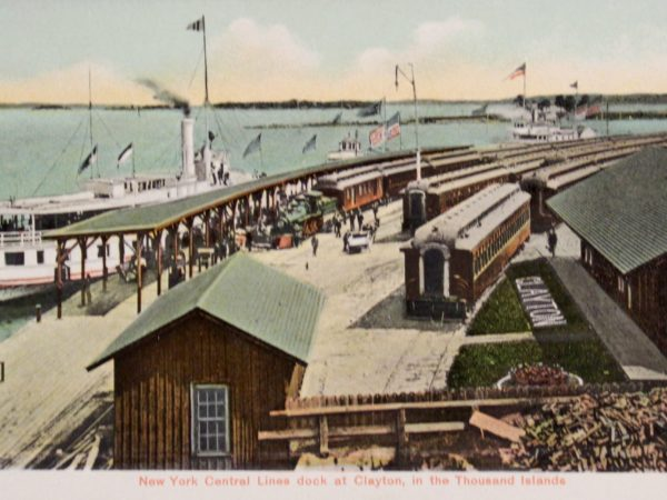 Postcard showing the train station and docks in Clayton