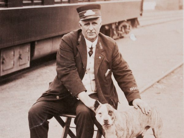 A train conductor with the station dog in Clayton