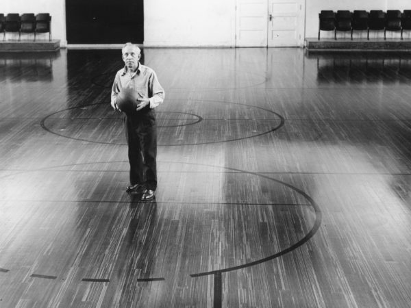 Janitor John Yerman in the gym of Town of Webb High School