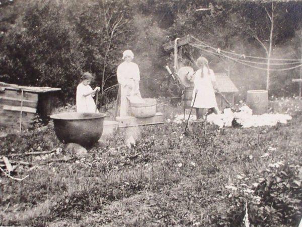 Three women washing clothes in Arietta