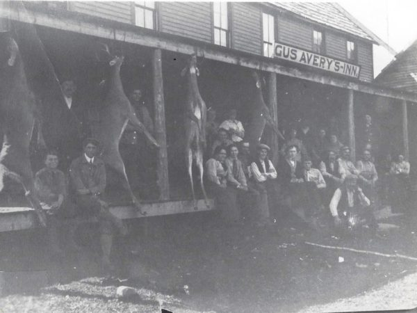Hunters on the porch of Avery's Inn in Piseco