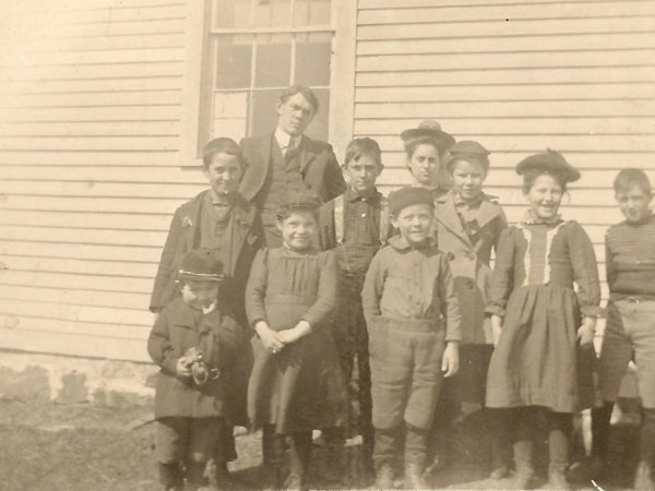 Teacher and students at District 3 School in Benson