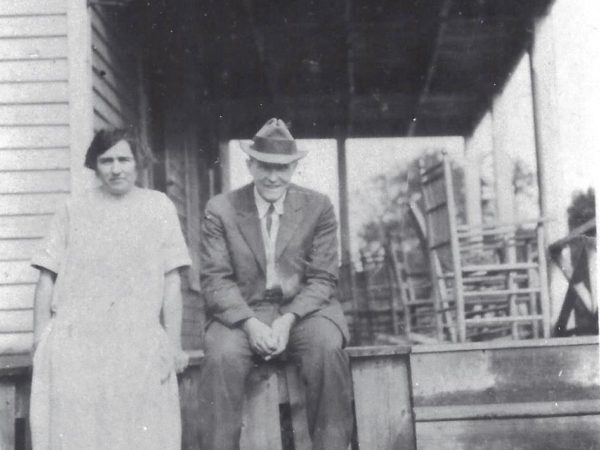 Two men in front of Avery's Inn in Piseco