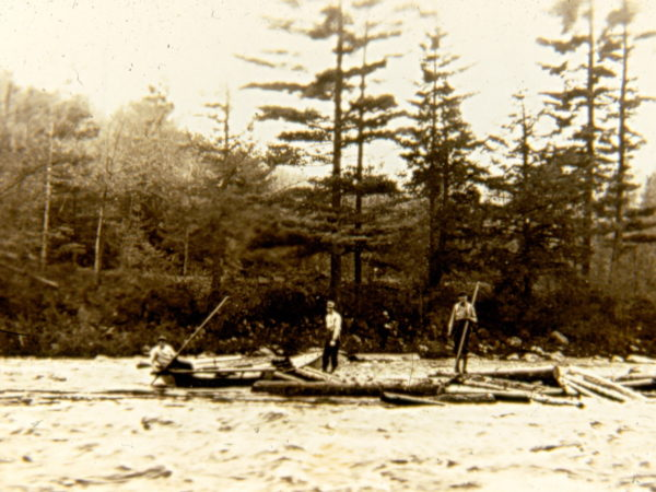 Log driving on the river in Hope