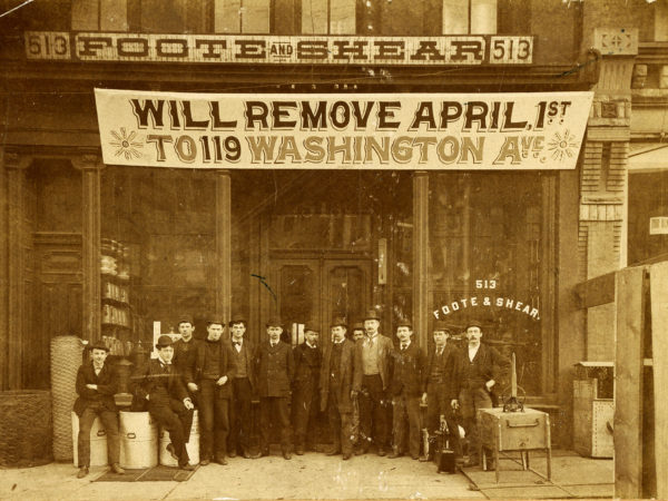 Men in front of Foote & Shear Hardware in Carthage