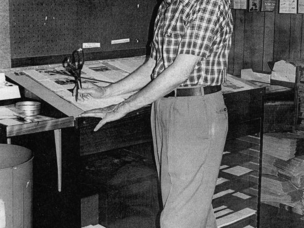Ray Hansen pasting up the front page of the Carthage Republican Tribune in Carthage