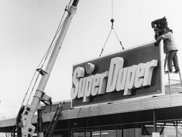 Putting the sign on the Super Duper in West Carthage