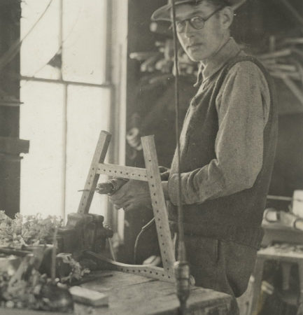 Wallace Emerson, Jr. at work in guideboat shop in Long Lake