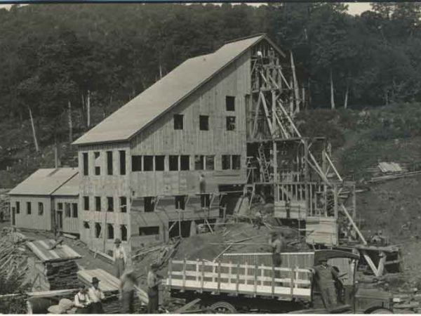 Putting siding on the American Glue Company mill in Minerva