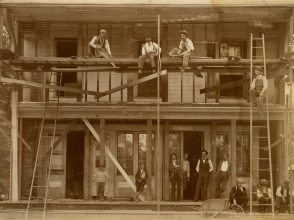 Building an addition on the post office in New York Mills