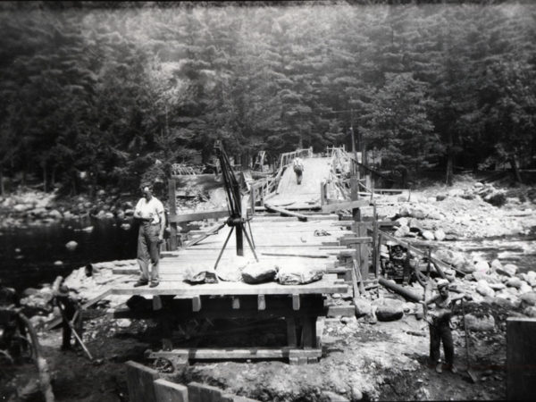 Civilian Conservation Corps workers build bridge in Speculator
