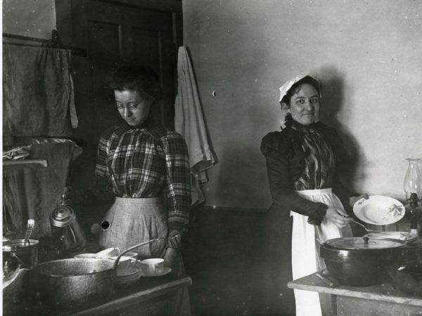 Women working in kitchen in Saranac Lake