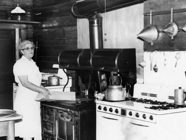 Woman in the kitchen of Camp Uncas in Racquette Lake