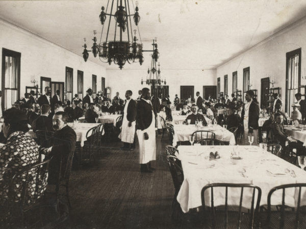 Waiters and guests inside the dining room at Prospect house in Blue Mountain Lake