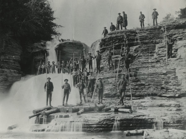 Loggers with pikes at Kings Falls on Deer River in Denmark
