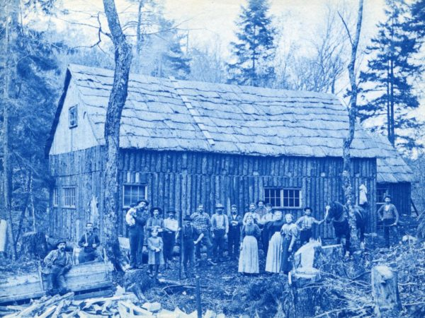 Crew of J. Schriner's lumber camp with their families in Morehouse